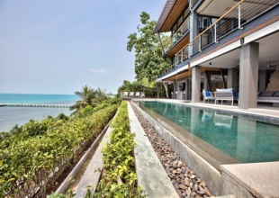 An inspiring oceanfront classic that takes elegant tropical luxury to the next level
